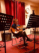 Young girl studen taking Guitar lesson in St albans