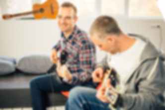 two men playing guitar in st albans guitar lesson
