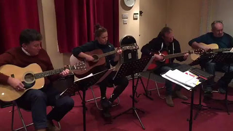 Adult Guitar Lessons   Students playing Wonderwall