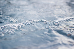 bubbles on the surface of blue water