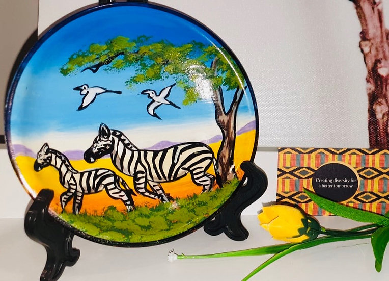 6 Inch round hand painted sandstone paintings including easel.