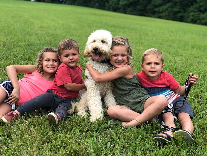 Teddy with kids.jpg