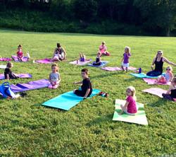Kids yoga group outside
