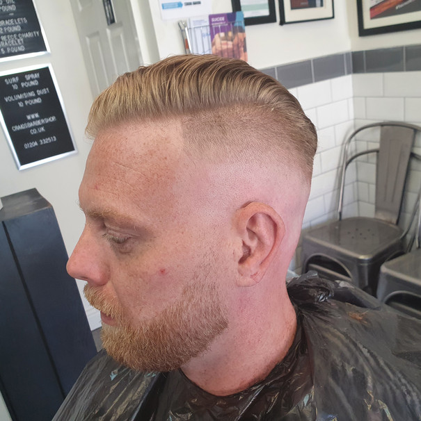 high skin fade with side part