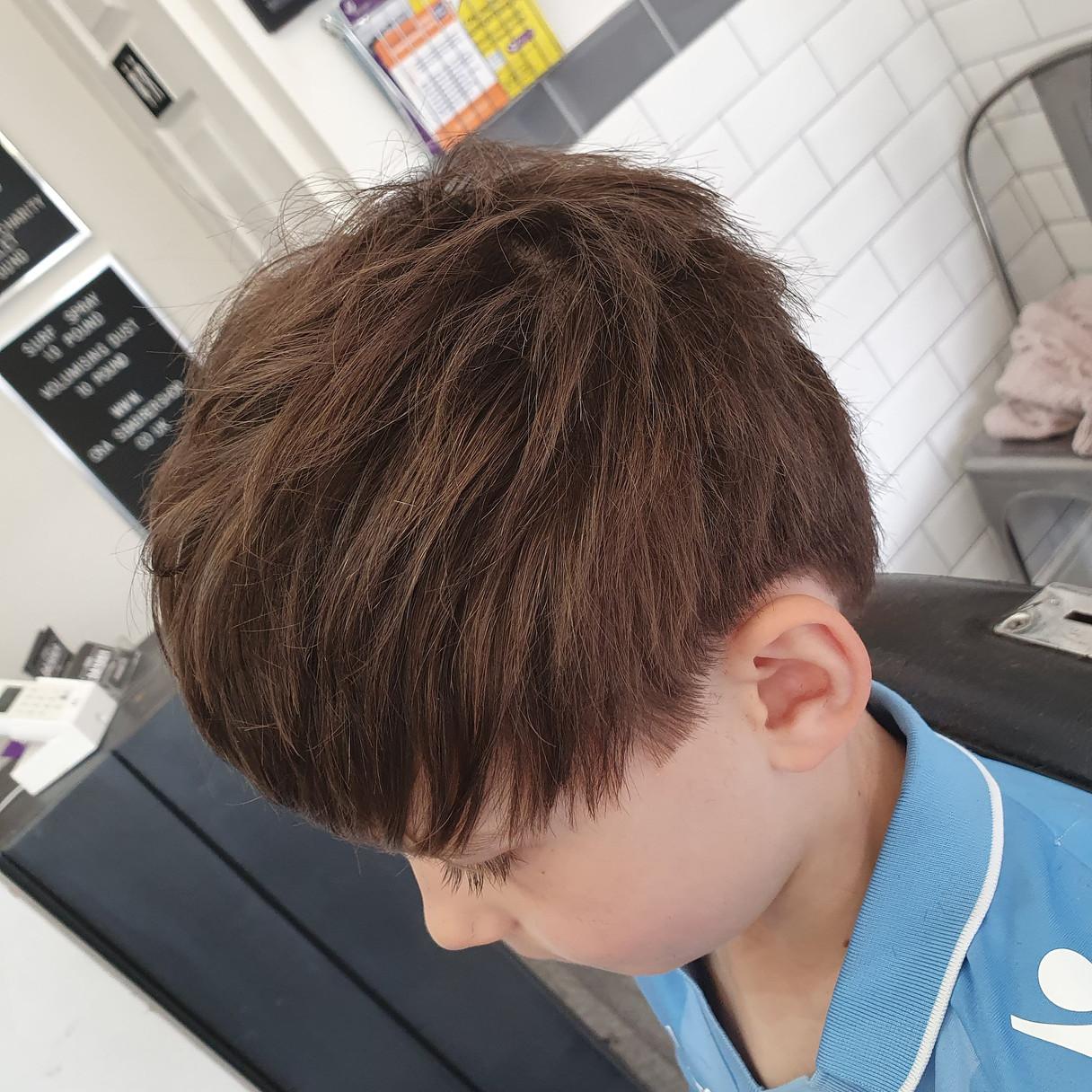 textured longer child haircut