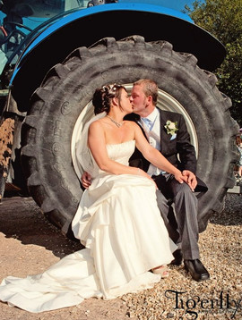 bride and groom with tractor.jpg