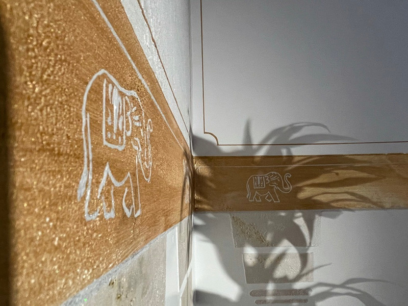 Elephants marching in gold