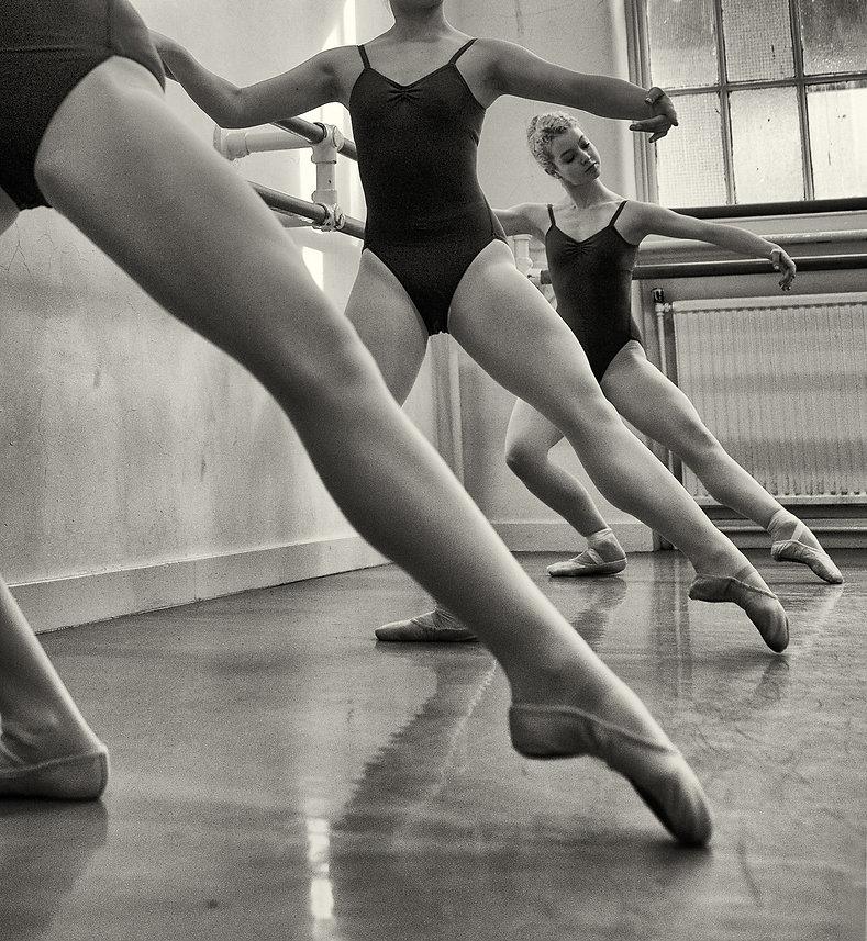 Ballet dancers exercising on the Barre .jpg