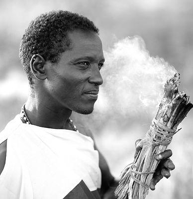 Preparing to smoke out bees - northern Kenya
