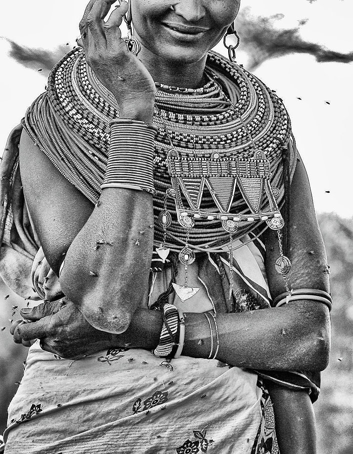 Kenyan tribal mother & flies.JPG