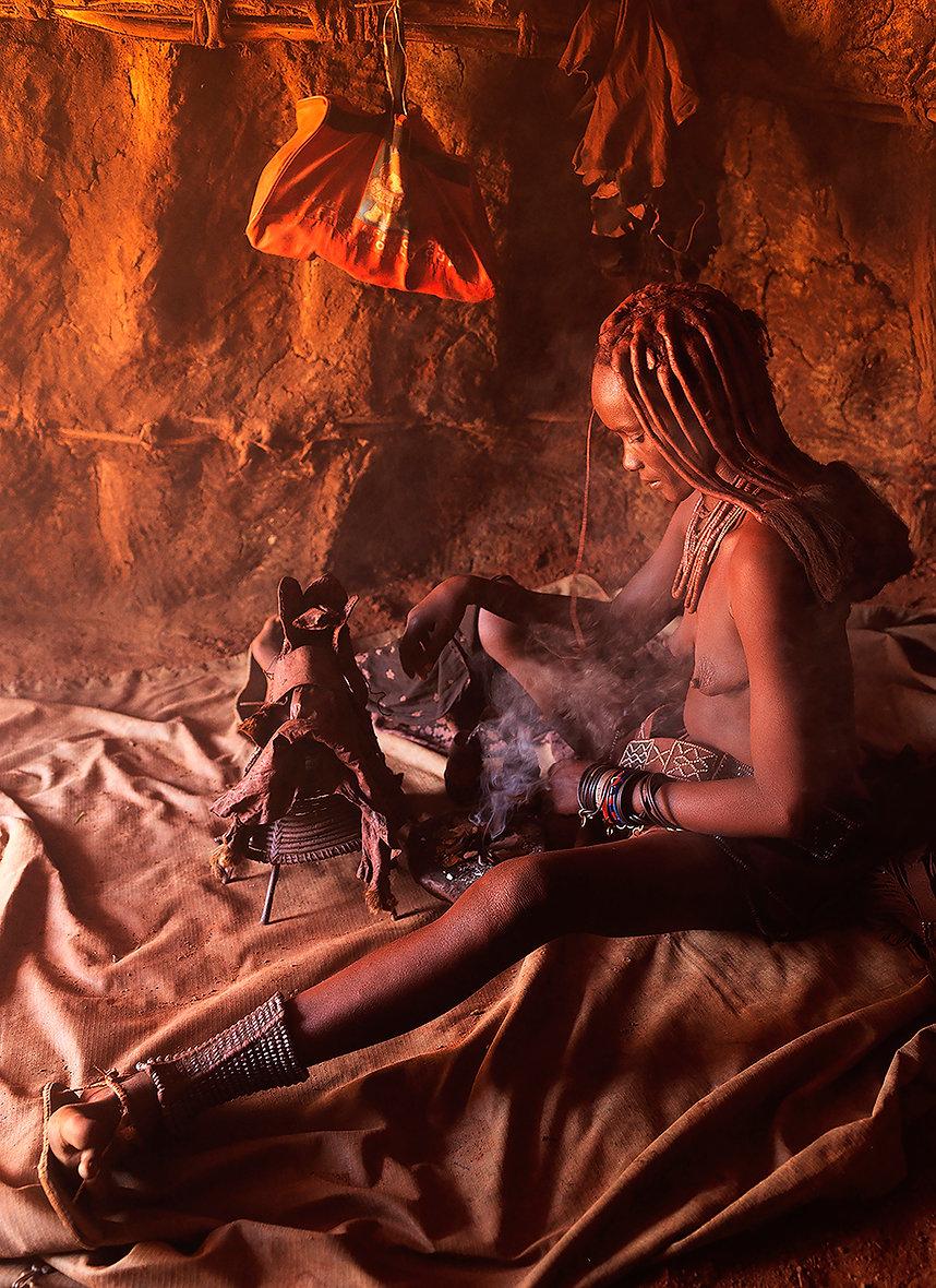 Himba woman performing a ritual in Northern Namibiag
