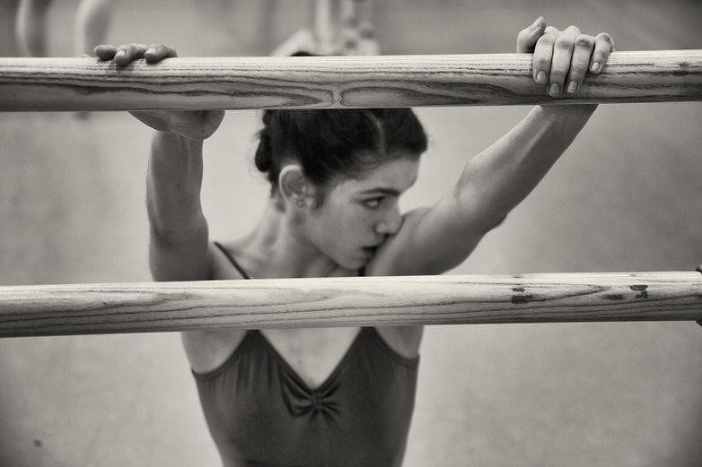 Ballet dancer tired on the barre