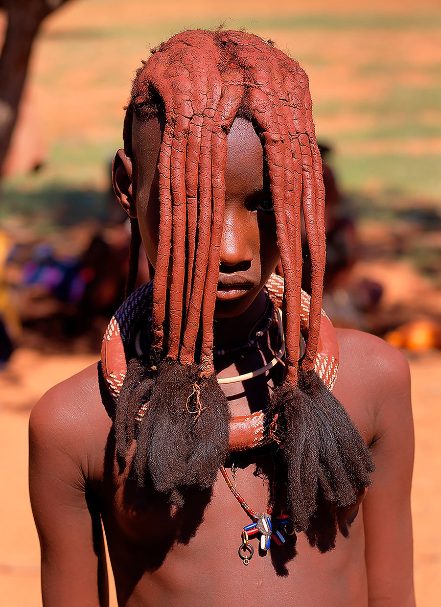 Himba girl with mud encrusted hair from Kunene, region, Northern Namibia