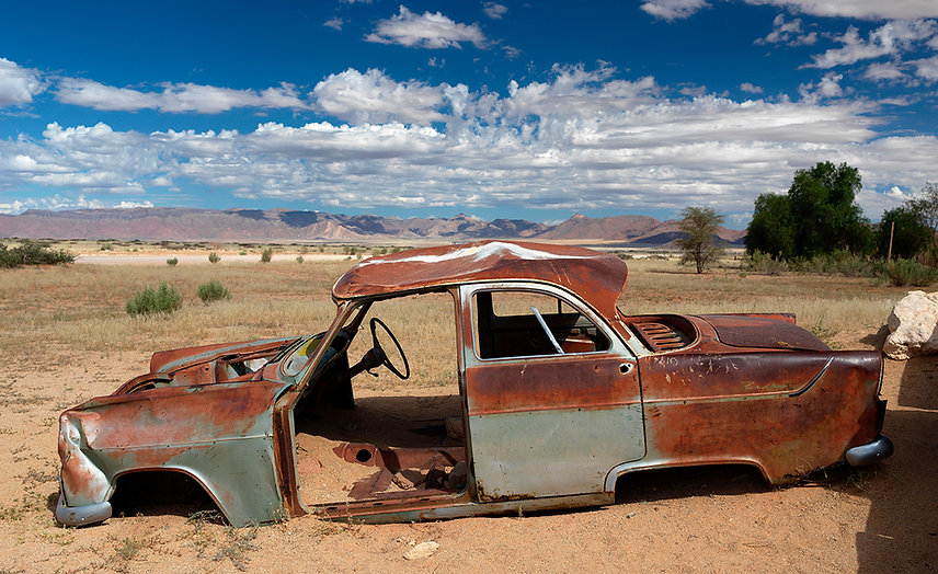 A rusting car in the Namibian desert