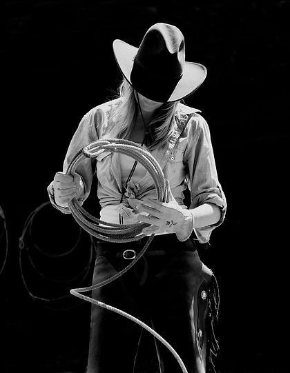 Woman wrangler practising with a lariat jpg