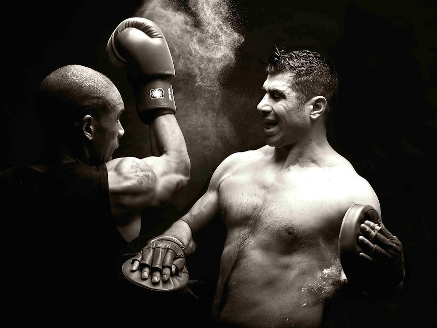 Two boxers sparring in a studio
