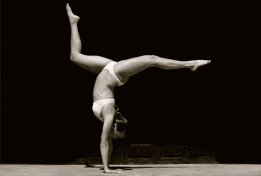Gymnast against a dark wall in Marrakesh, Morocco, monochrome by Michael Potter