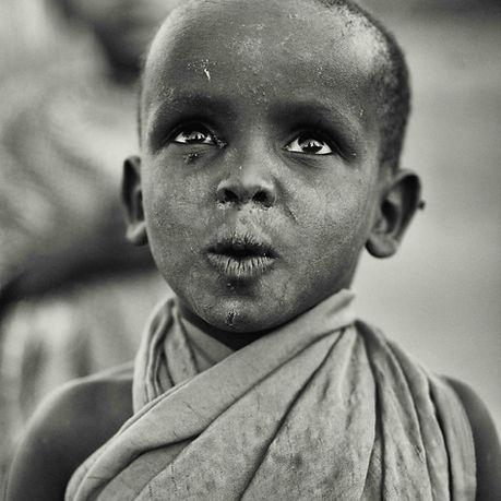 Kenyan village boy whistling