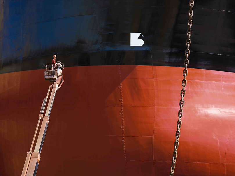 Painting  a ship in the Romanian drydock