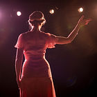 performer-on-stage-in-theater-lights_446