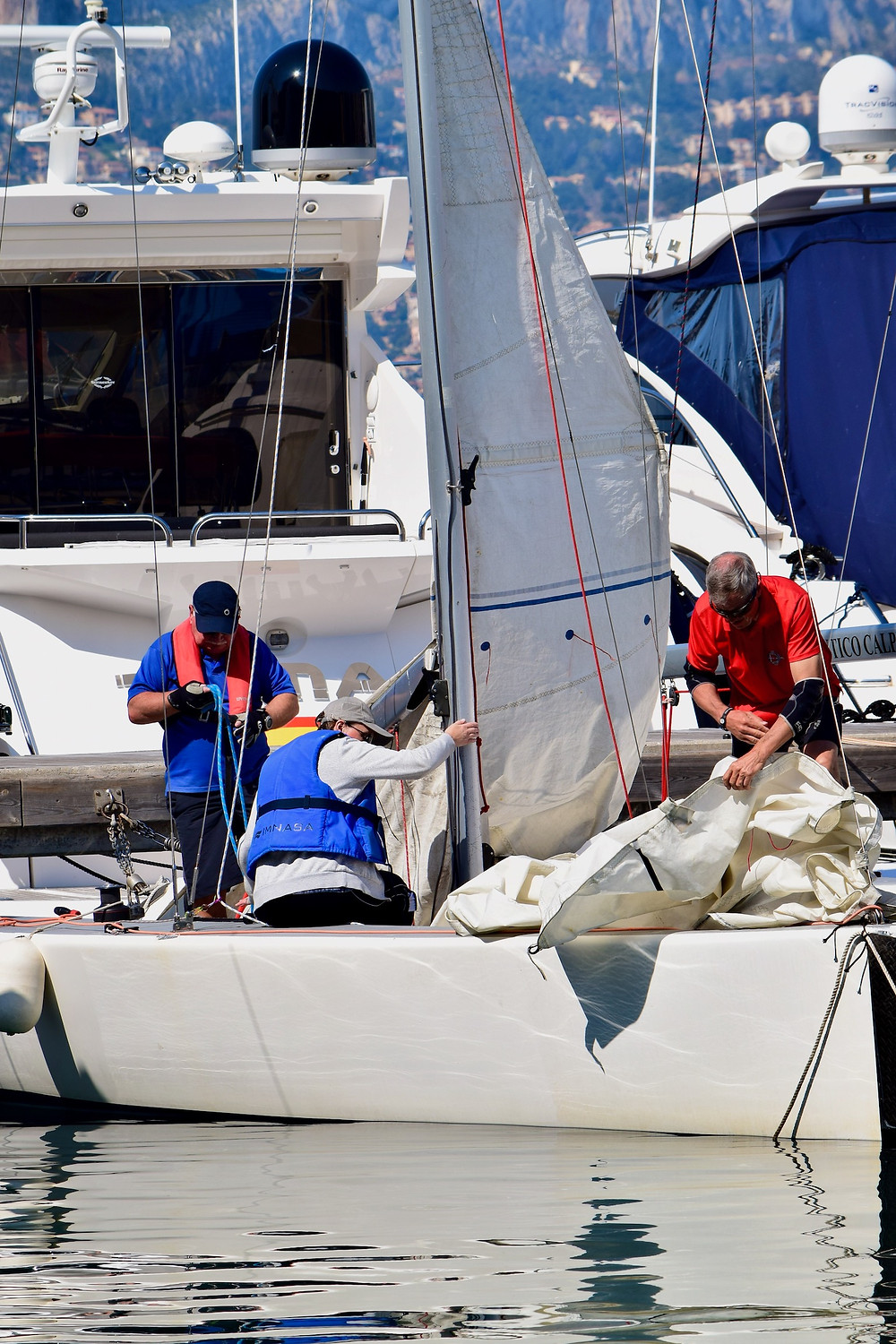 Rigging the yacht, a TOM28 prior to setting sail.