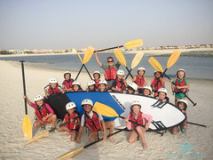 Children having fun with stand up paddle boards