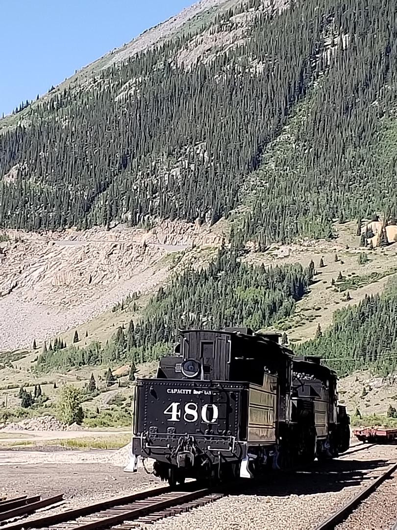 A historic steam locomotive in the mountains