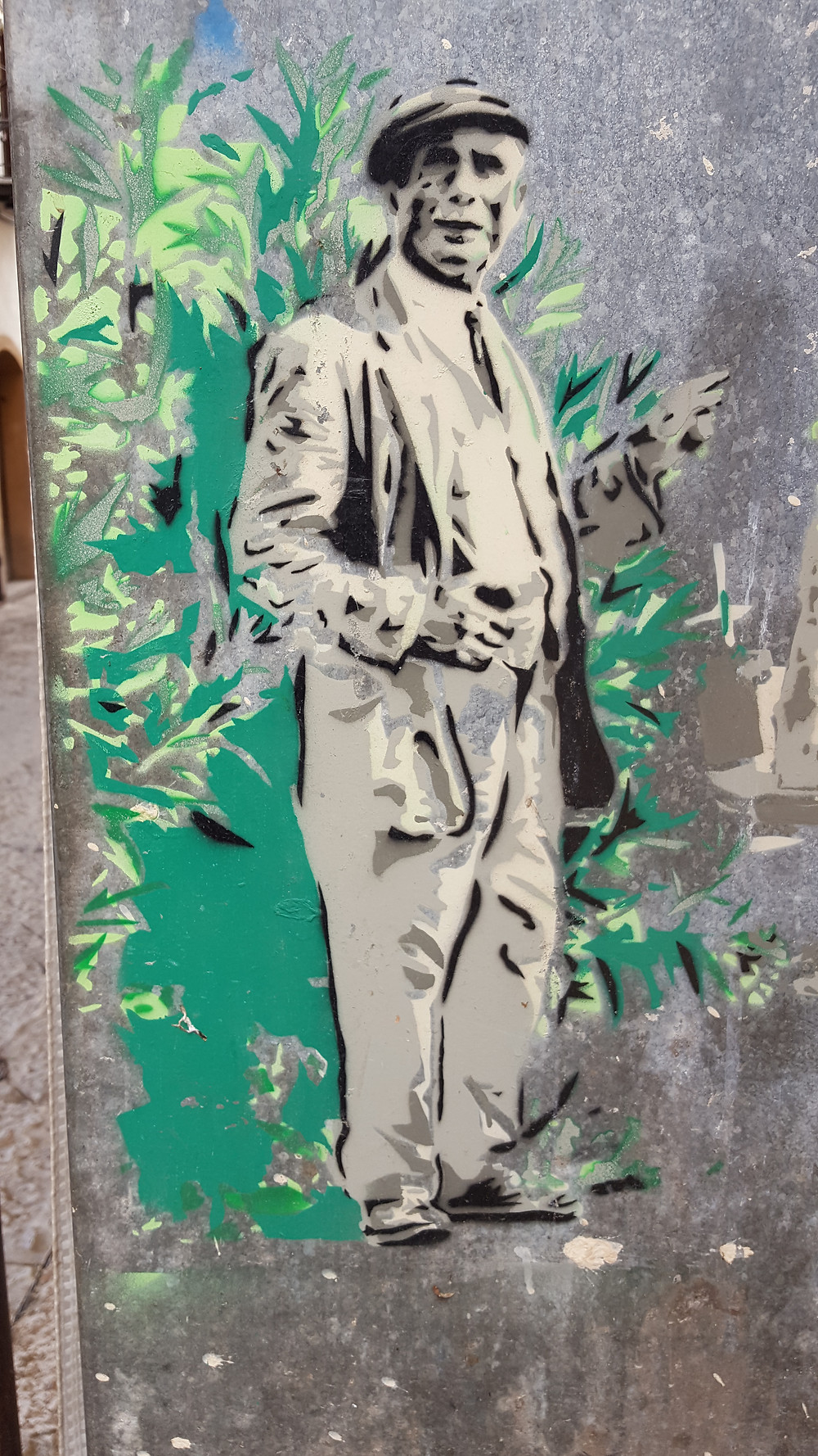 street art picture of an old Sicilian man with a hat