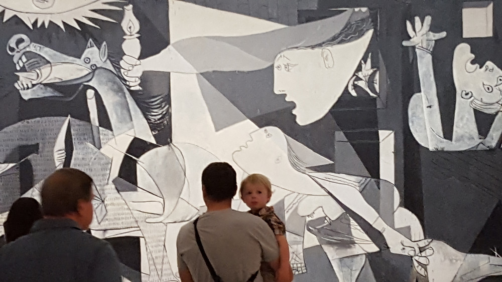 Boy in front of Picasso's Guernica painting