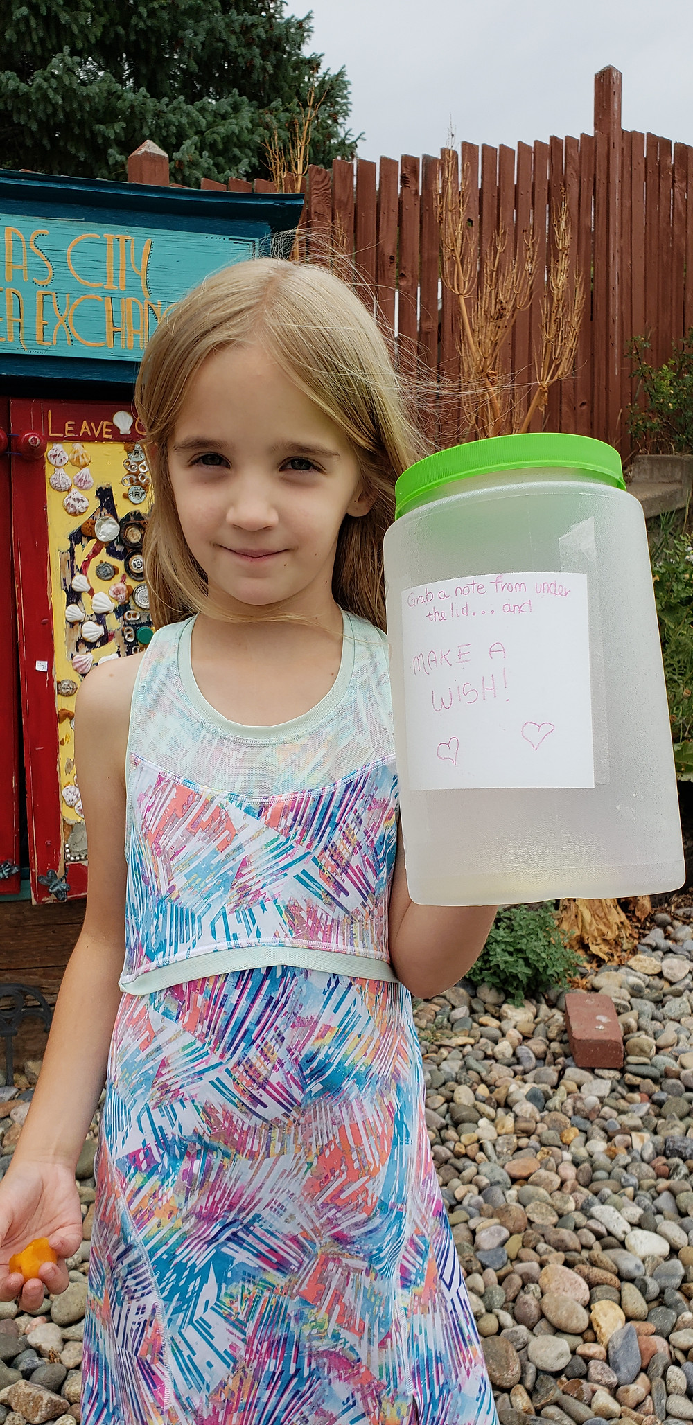 Little girl holding a jar for wishes