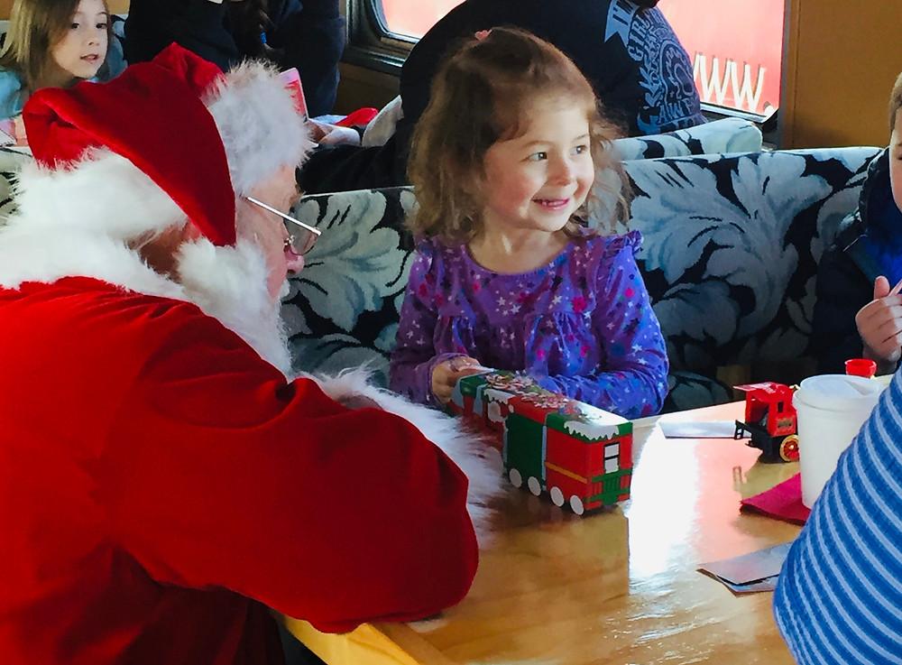 Santa giving gift to girl