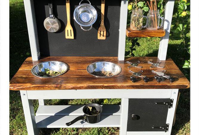 Outdoor play kitchen with pretend oven for nursery school garden in Richmond