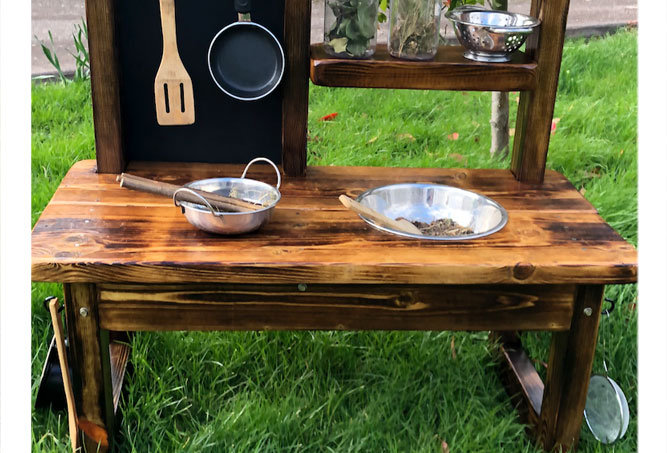 Custom mud kitchen for disabled child to sit down play