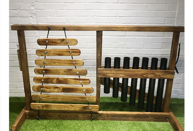 Large outdoor drum and pipe musical therapy stand for special needs