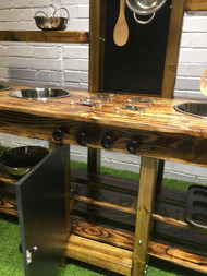 Mud kitchen with oven play features