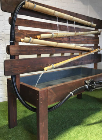 Wooden outdoor hand water pump play table