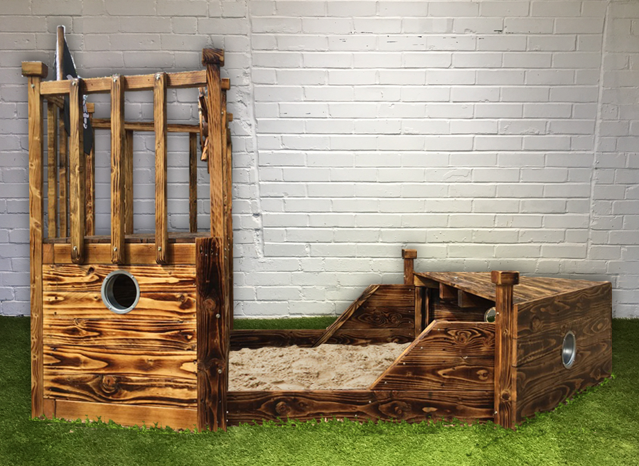 Wooden outdoor pirate boat sand pit