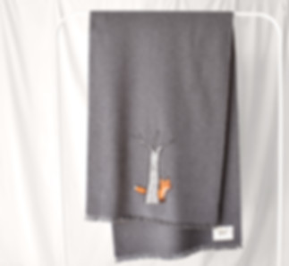 woolen cashmere shawl with hand-printed fox behind a tree