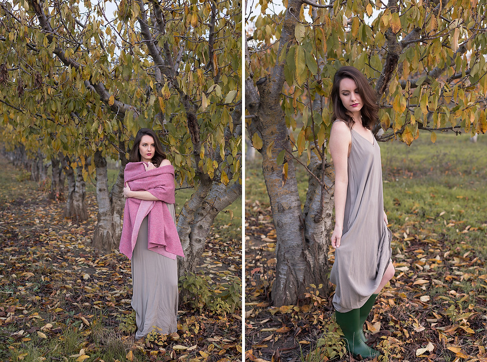 model posing in yellow leaves in orchard