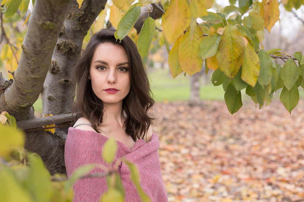 The model sitting underneath the pear tree in the orchard at Martial Cottle Park during the editorial portrait session.