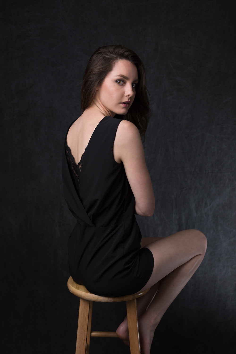 The model sitting on a stool during an editorial portrait session at my studio in San Jose.