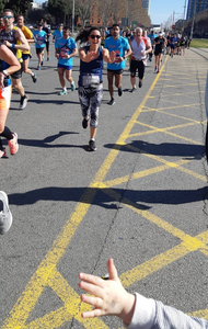 When was the last time you did something for the first time? Olga, ISPIM Scientific Coordinator, running her first marathon and high-fiving the ISPIM support at km 26.