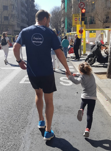 """Steffen Conn, ISPIM Operations Director, joined by the team's """"biggest"""" cheerleader at KM 41!"""