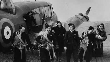 ATA women getting out of transport plane