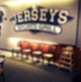 Jersey's Sports Grill sign and chairs