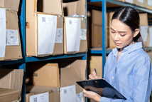 asian-businesswoman-writing-inventory-ch