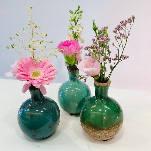 Trio vaasjes SERAX met snijbloemen (roze)