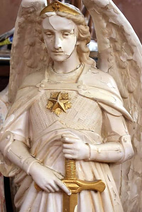Saint-Michael-statue-before-restoration.jpg