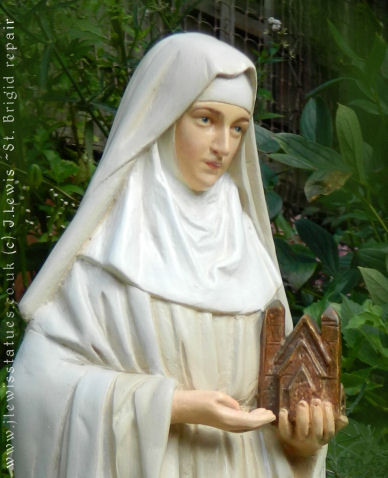 Plaster statue of St.Brigid restored