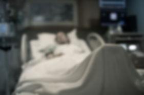 hospital bed unrecognizable.jpeg